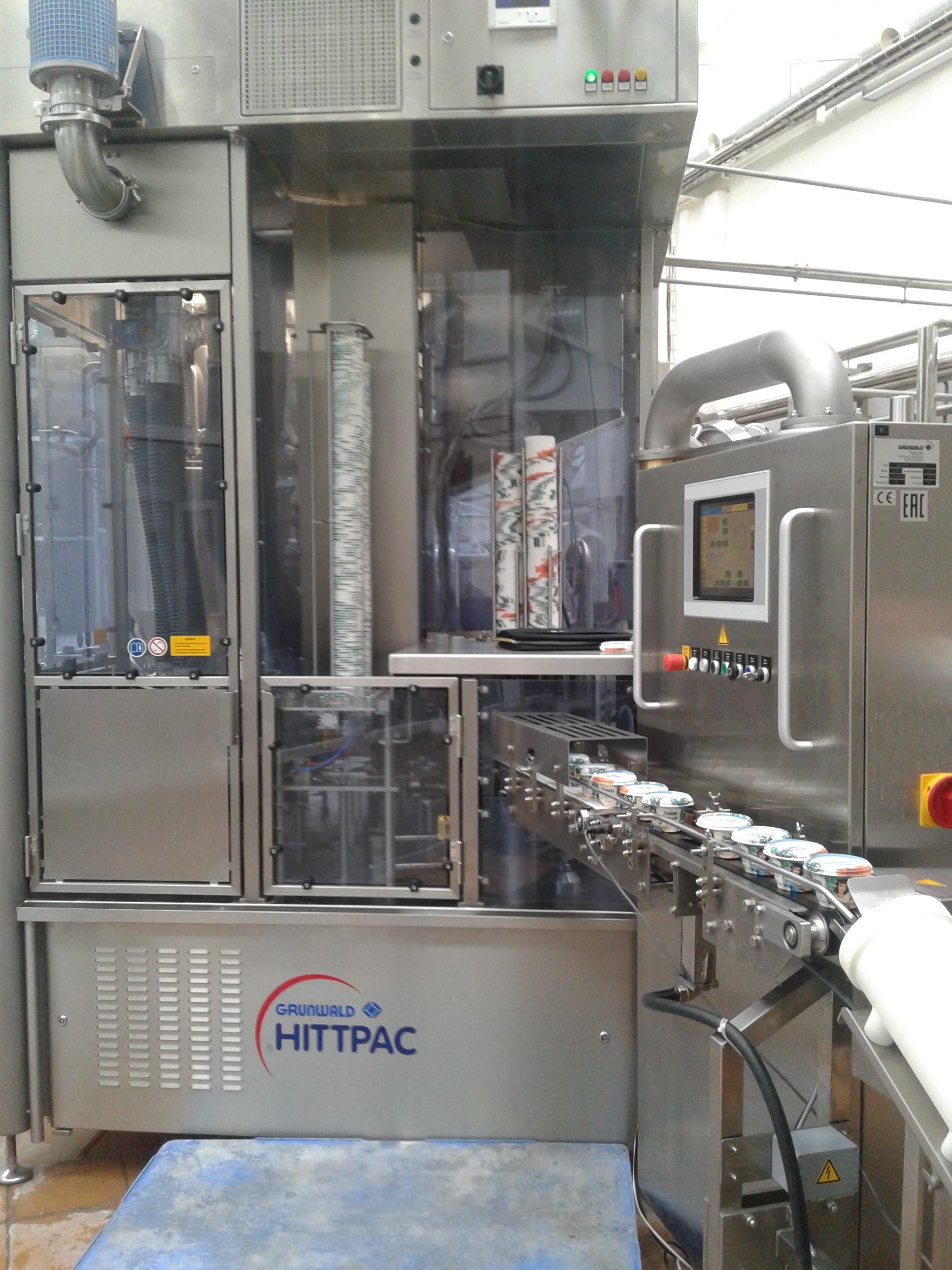 Очередной запуск автоматической машины для наполнения и запечатывания стаканчиков  GRUNWALD-HITTPAC AKH-059